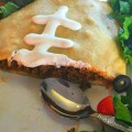Football shaped Crescent Taco. Perfect for football parties. Easy and delicious. www.kidfriendlythingstodo.com
