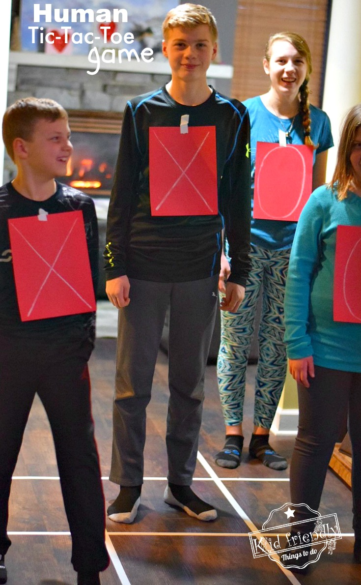 Human Tic-Tac-Toe - A Valentine Party Game to Play With Kids, Teens and Adults. This is such a fun game. Perfect for holiday parties like Valentine's Day, Christmas and even New Years Eve! www.kidfriendlythingstodo.com