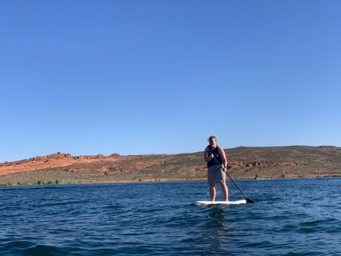 A person paddle boarding  Description automatically generated with low confidence