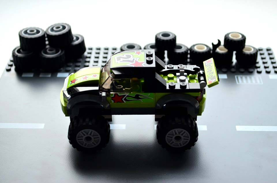 Lego Monster Truck driving on a lego road plate