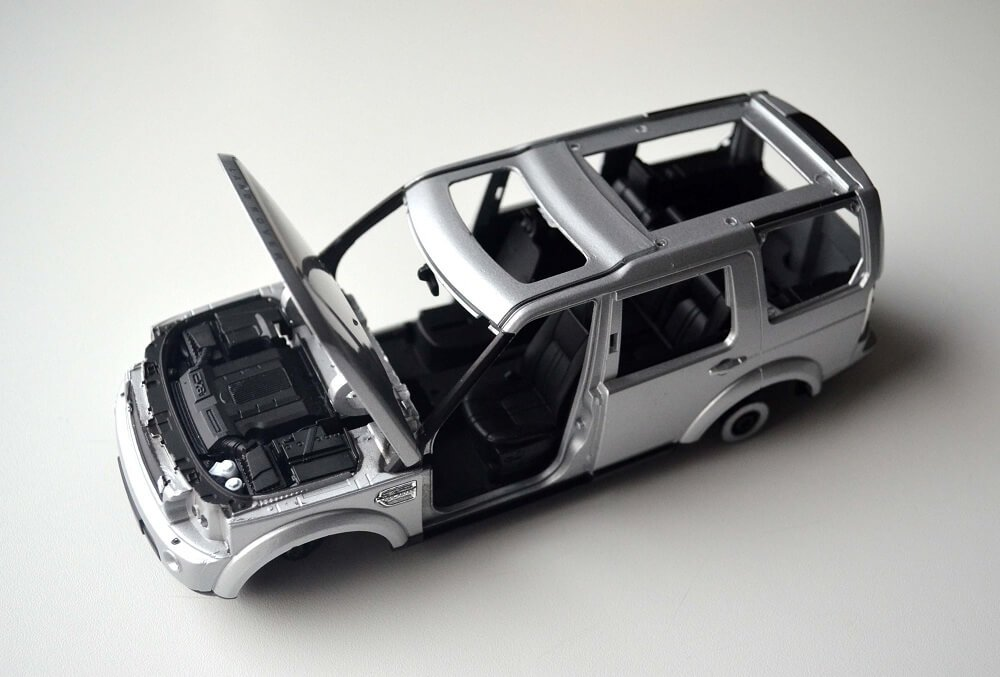Dismantled 1:24 scale diecast Welly toy car