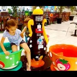 Fun at the indoor  playground. Children playing in toy ships and toy cups. Nice video