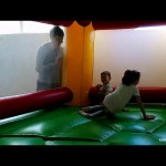 Indoor playground for fun. Kids jumping and  turn around in a bouncy castle . Nice video