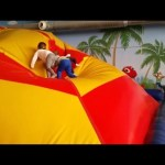 Indoor playground fun for kids with inflatable hill