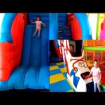 Indoor playground with inflatable slider. Video from KIDS TOYS CHANNEL