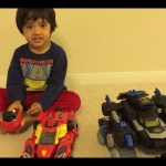 Kid playing with toys Vtech Switch and Go Turbo Bronco the RC toy , Fisher-Price Imaginext Batbot