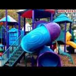 Outdoor playground fun for children. Kids playing in the park on sliders. VIDEO KIDS TOYS CHANNEL
