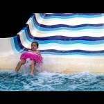 Water slide for kids at aqua park. Funny video 2015