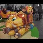 Indoor playground for kids with funny carousel.  Video from KIDS TOYS CHANNEL