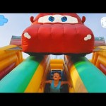 Outdoor playground for kids with bounce toys. Kids playing video.