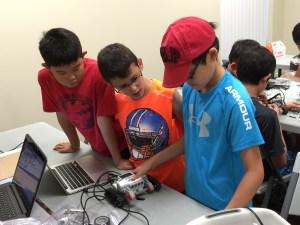 Kids at JEI starting their first robot.
