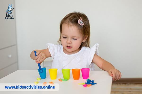little girl sorting animals