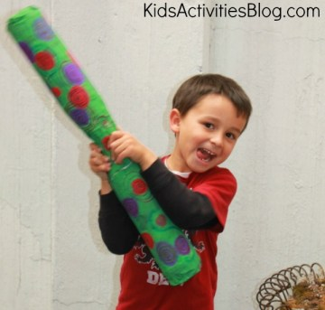 boy with rain stick 10 Kid Craft Ideas for Earth Day