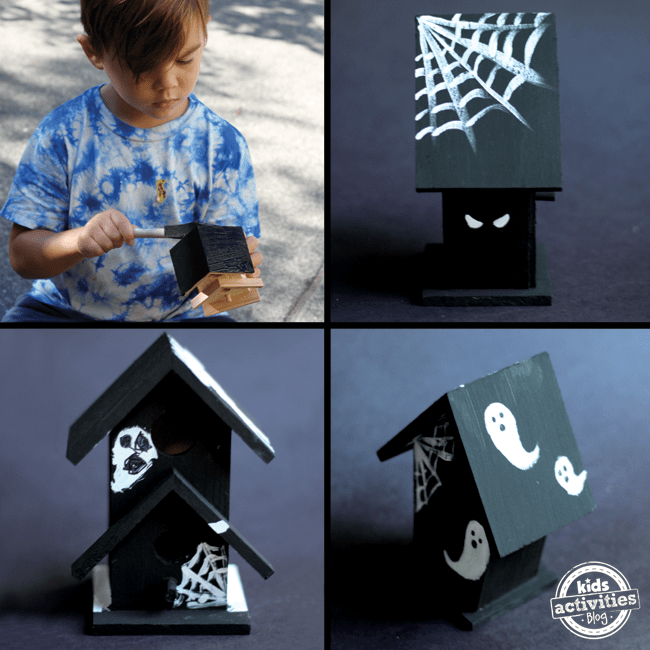 halloween craft- haunted houses made from a bird house, painted black, with white ghosts on it and spider webs.