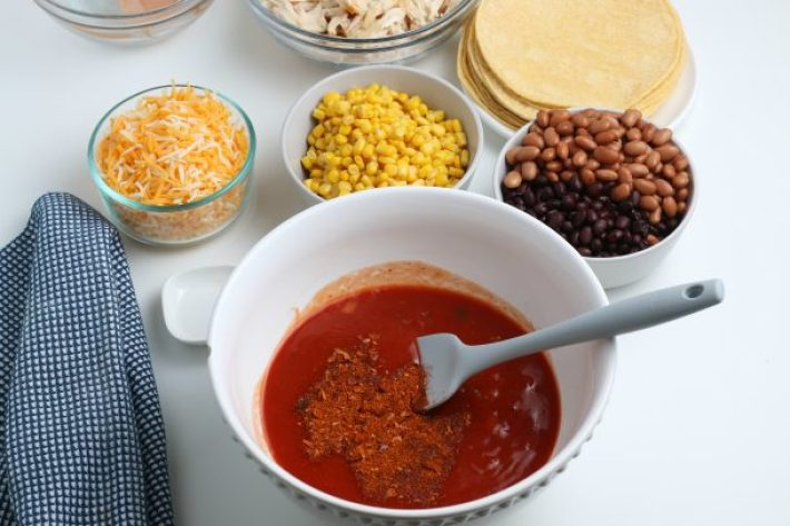 Easy Chicken Enchilada Casserole Recipe - Step mix the the enchilada sauce with your spices