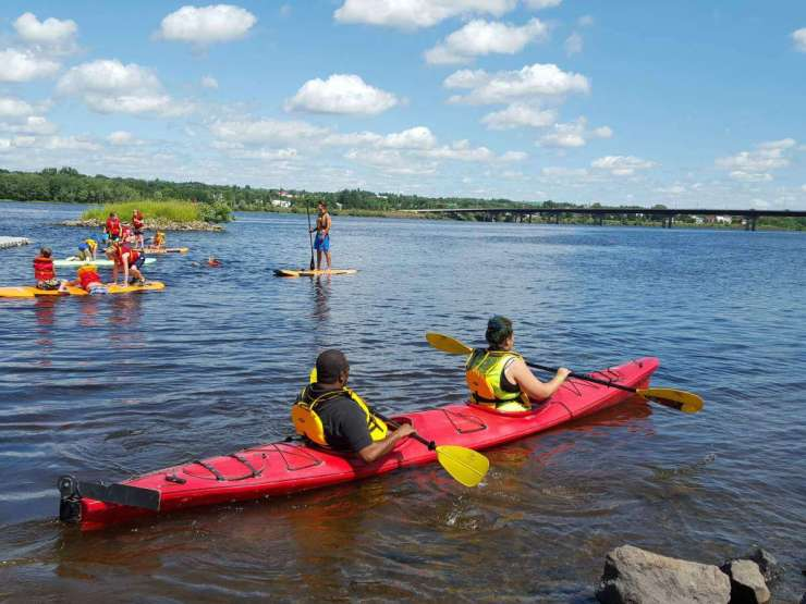 Family friendly things to do in Fredericton, New Brunswick kayaking on the river-Kids Are A Trip