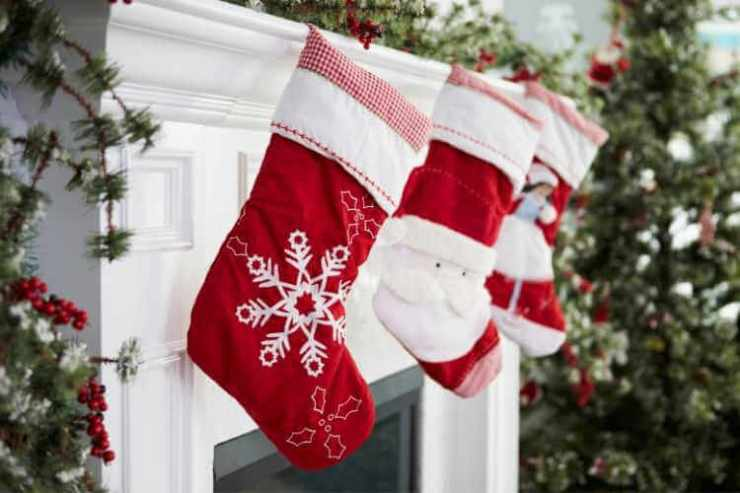 Holiday stockings hanging by chimney-Kids Are A Trip