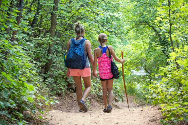 Woman hiking with child