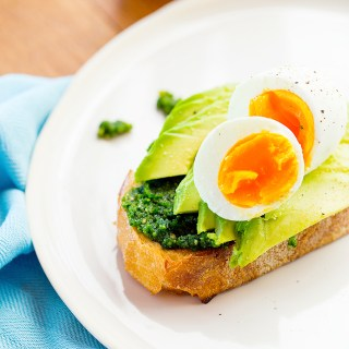 breakfast of pesto, avocado & egg on sourdough toast