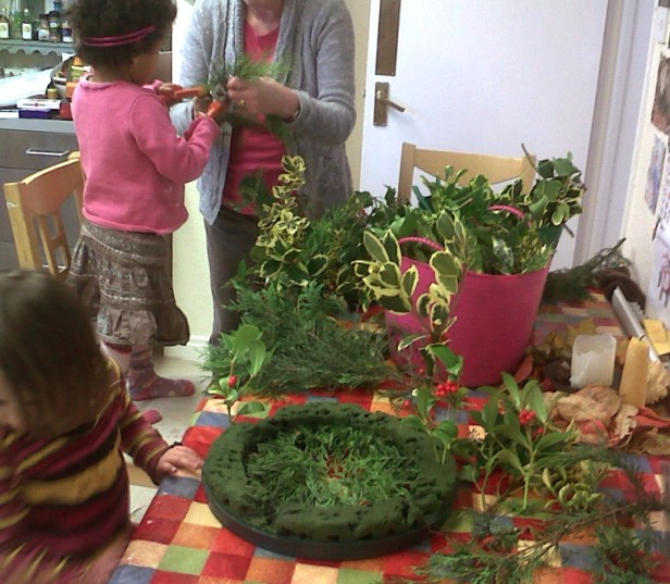 children-at-a-table-with-everygreens-and-a-wreath