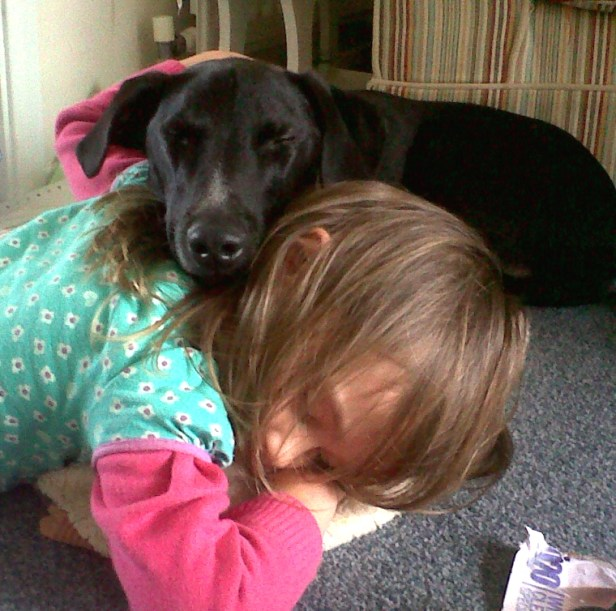 girl-asleep-on-floor-with-dog-asleep-on-her-back