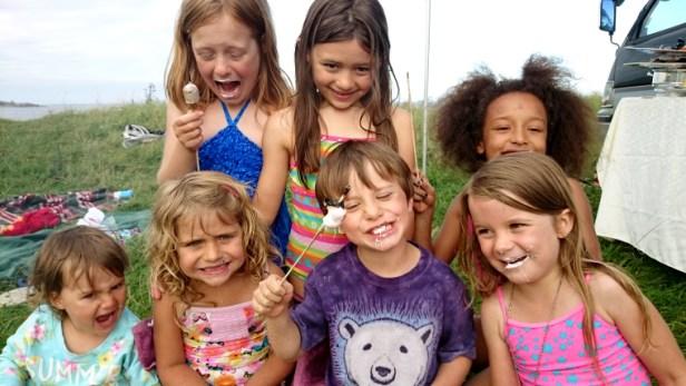 group-of-children-eating-marshmallows