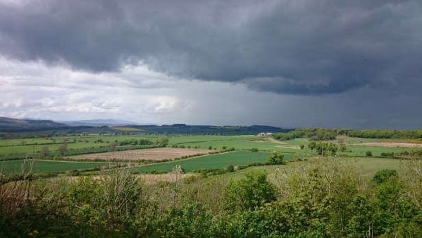 incoming-rainstorm-over-hills-and-fields-ratcheugh-crag-northumberland