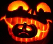 Image of pumkpin-carved with-baby-pumkin-in-mouth