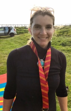 Image of woman-in-black-top-with-harry-potter-tie-on-mcgonogall-costume