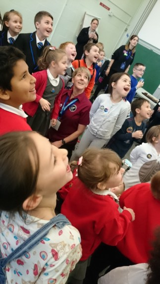 Image of children-laughing-and-looking-towards-the-ceiling