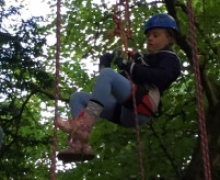 Image of girl-in-climbing-harness-in-tree-2