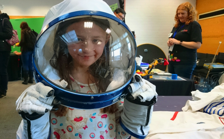 Image of girl-in-space-helmet-and-space-gloves
