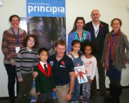 Image of group-of-people-and-children-with-astronaut-tim-peake-and-principia-poster