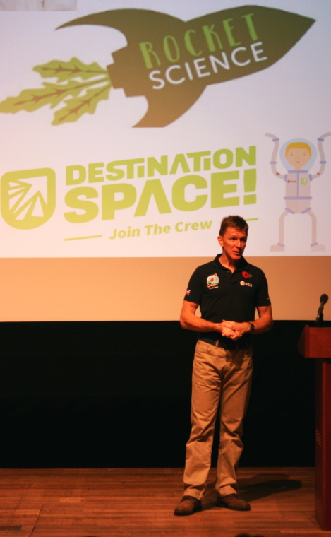 Image of tim-peake-giving-talk at-principia-space-conference-with-rocket-science-logo-behind