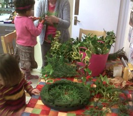Image of children-at-a-table-with-everygreens-and-a-wreath