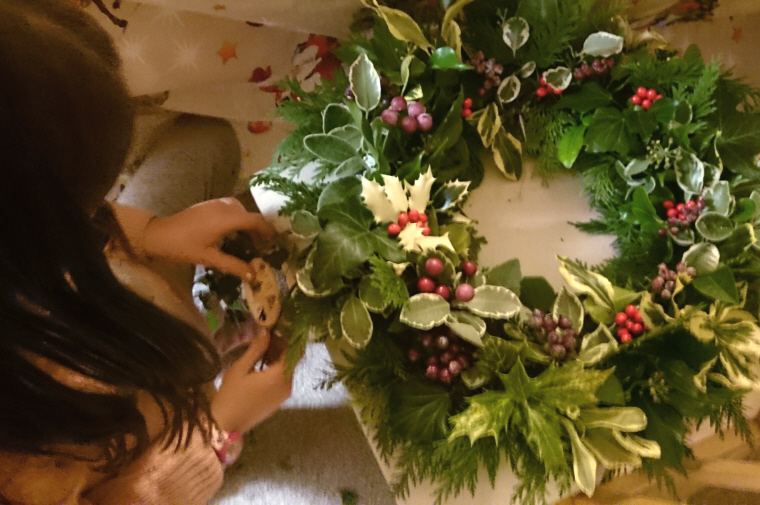 Image of girl-with-completed-evergreen-wreath