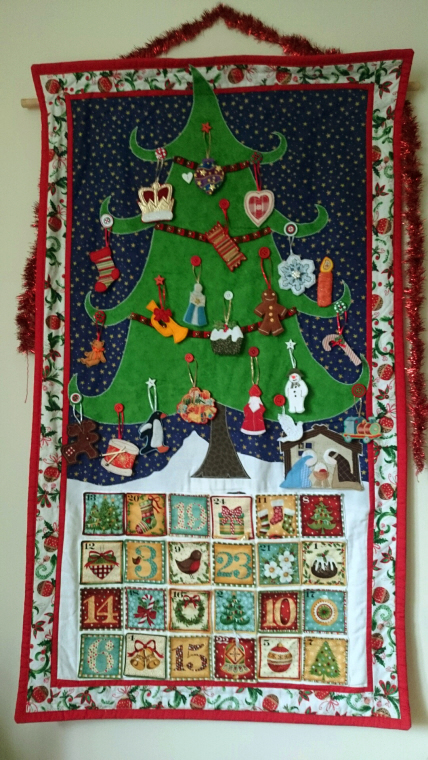 fabric-advent-calendar-with-numbered-pockets-large-fir-tree-on-snow-with-decorations-and-starry-background
