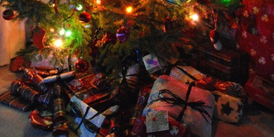 Image of gift-wrapped-christmas-presents-under-tree