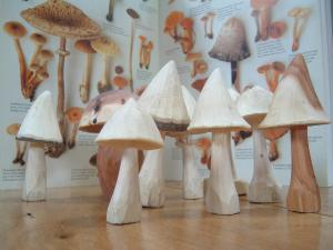 Image of group-of-wooden-carved-miniature-mushrooms