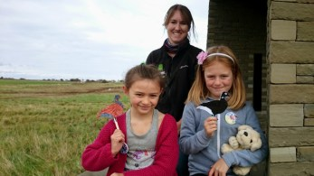 Image of woman-and-two-girls-on-wall-with-holding-craft-ducks-in-front-of-heathland