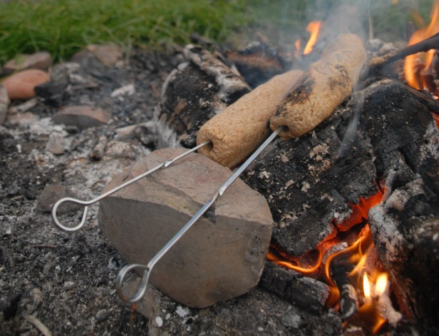 damper-bread-cooking-rock-in-campfire