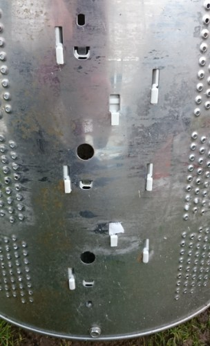 Image of exterior-of-washing-machine-drum-showing-plastic-inserts