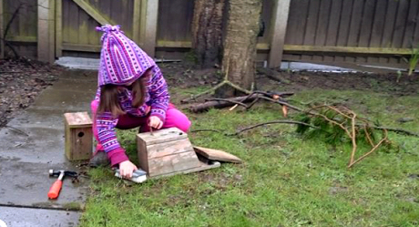 Image of girl--in-garden-cleaning-nestboxes