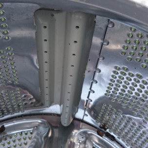 Image of inside-of-washing-machine-drum-showing-plastic-insert-clips