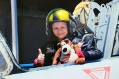 Image of girl in helmet in open cockpit