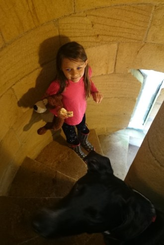 Image of girl on stone spiral staircase