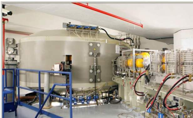 Cyclotron atom splitter machine in room with machinery