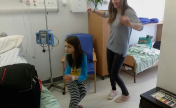 image of woman with child in pyjamas dancing in hospital room