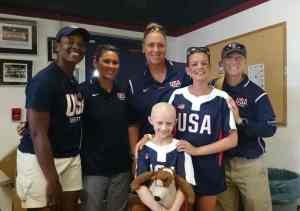 Image of girl and teenager with 4 women in USA softball shirts