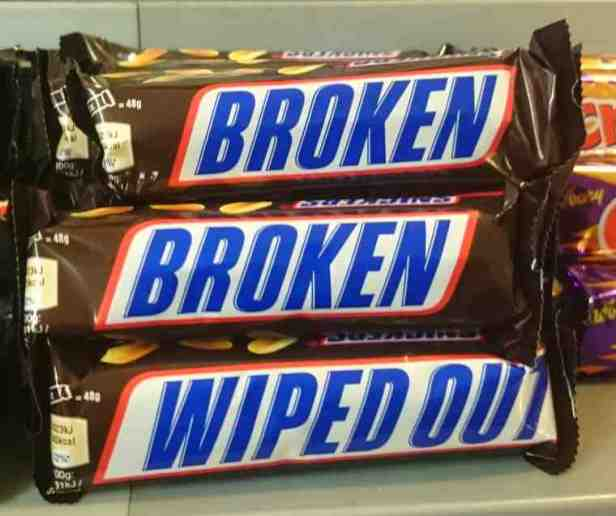 Image of bars of chocolate with Broken and Wiped Out on the wrapper instead of the brand name
